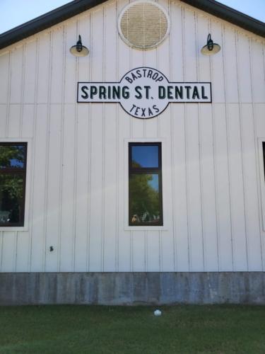 Spring St Dental Sign Portrait in Bastrop Texas